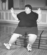 Photo of a man performing chair aerobics
